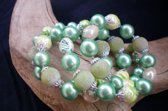 Green pearl memory wire bracelet. Recycled by OutsiderArtJewelry