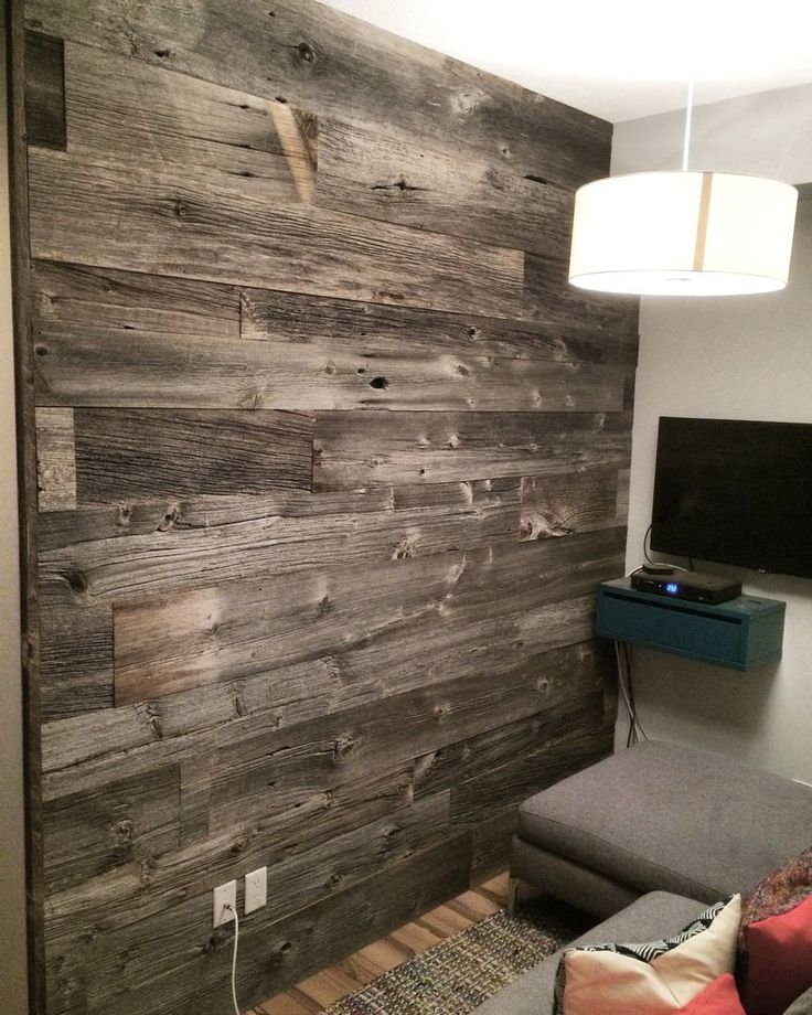 Reclaimed grey barn board feature wall by barnboardstore.com.  Authentic Ontario wood was used to add some charm and texture to this space.