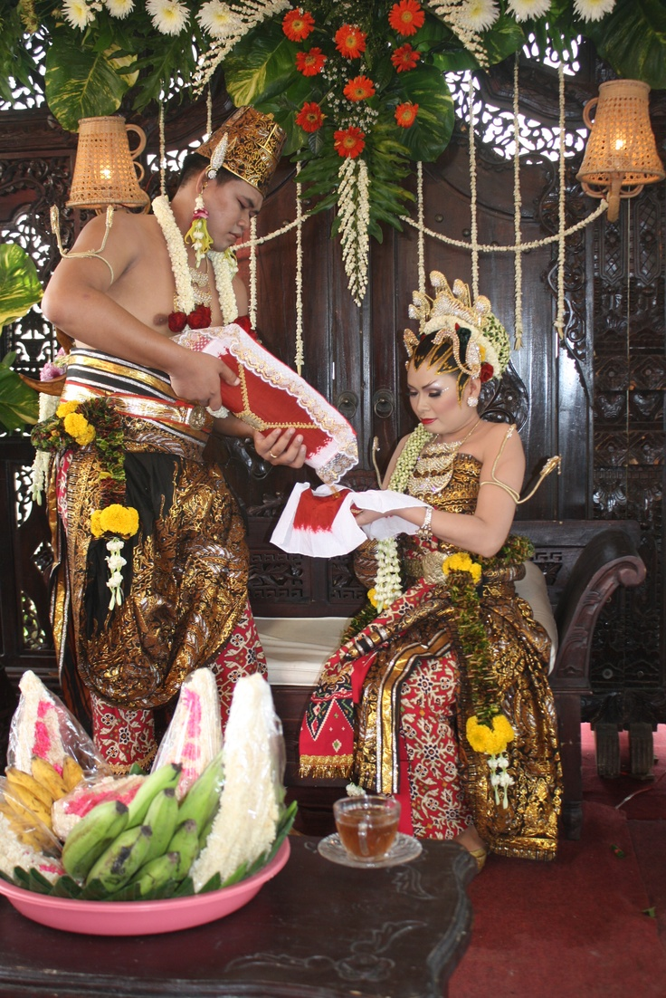 Pouring Water is one of several rituals in Javanese Marriage ceremony, It represent that a man must responsible to His wife and family, to give them food, drink,house and all the family needs for their own happines (Picture by Aryo Widiyanto, Cepiring-Kendal Regency-Central Java,Indonesia 51352)