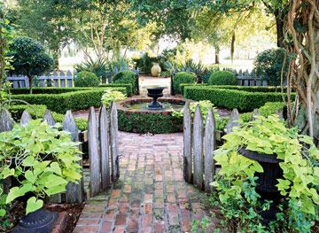 Brick Walkways All Lead to a Central Point One of the great things about brick is that pavers come in a plethora of colors and finishes. Create an old-world look in your backyard by mixing colors and withholding mortar typically placed between each paver. Have your pathway lead to a beautiful focal point, such as the water feature in this garden. To add to the mature appeal, this landscape boasts aged cypress fences that blend beautifully with the old brick.: