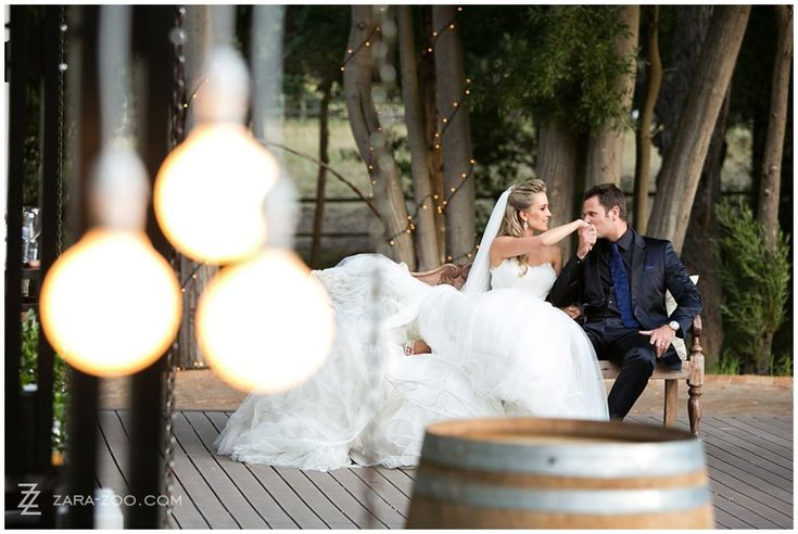 Couple sitting on chair (brides feet up).  Bride leaning into groom.  #Wedding at #Molenvliet Wine Estate near Stellenbosch, South Africa.  See more of this wedding on the ZaraZoo Photography blog http://www.zara-zoo.com/blog/molenvliet-wedding-photos-stellenbosch