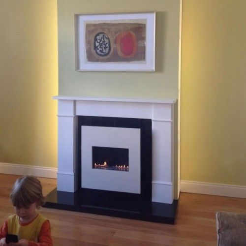 Liten Flueless Gas Fire With White Surround - The LITEN hang on the wall flueless gas fire is a smaller wall mounted version of our popular Classico or Moderno open flamed flueless gas fires. Running costs from 11p/hour and heat outputs from 2.7kw to 3.5Kw.