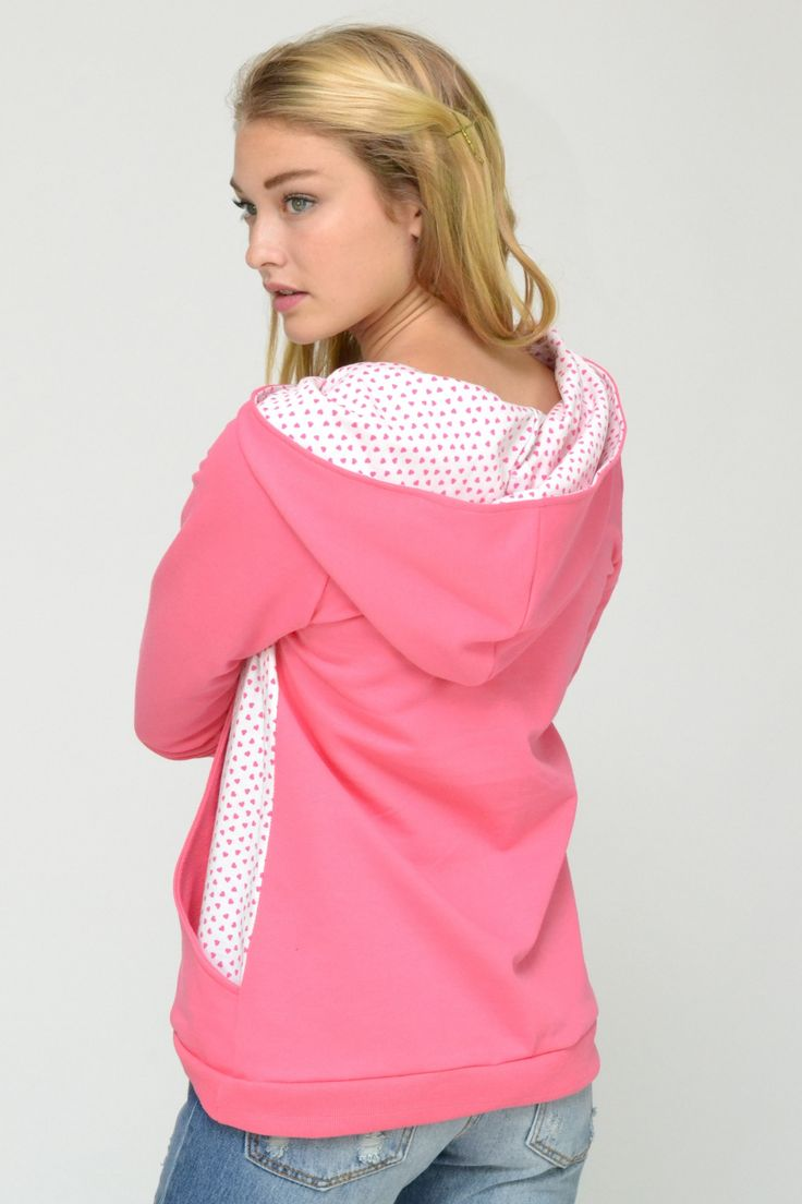 Pink hoody top with pink and white heart print large side pockets and hood.