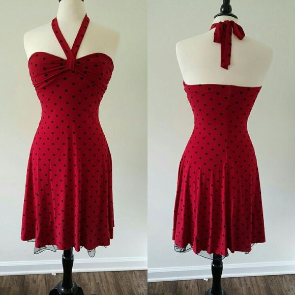Formal Dress Beautiful  Red & Black Polka-dot Dress, It ties at the neck and has tulle at the bottom.  In excellent condition only wore it once.  92% Polyester & 8% Spandex  Lining: 100% Polyester B. SMART  Dresses