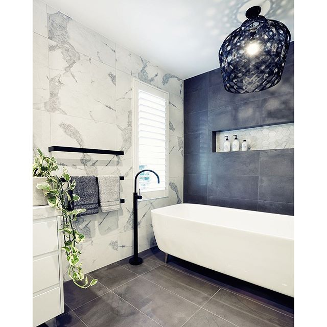 Bathroom by Gia Renovations featuring the Adairs Flinders Towels