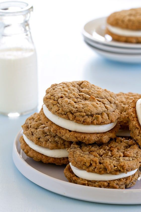 Soft and chewy oatmeal cookies are sandwiched together with delicious vanilla buttercream to create the perfect dessert.