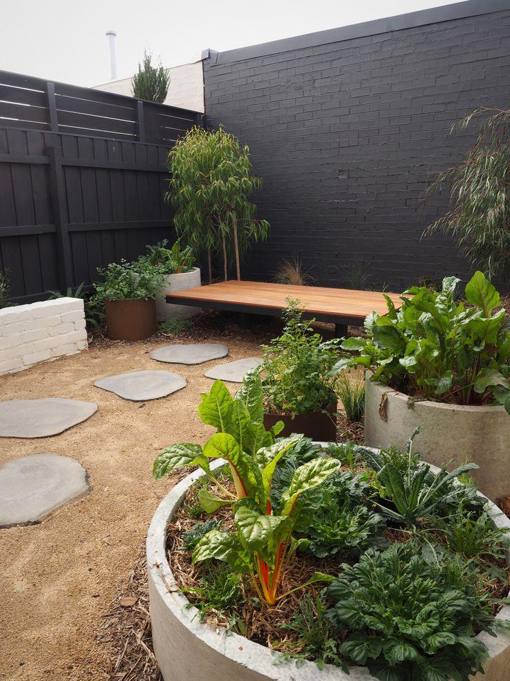 Coburg garden: concrete & corten veggie gardens, Blackbutt daybed and bluestone steppers.