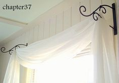 Some cool decoration uses here, especially the use of plant hangers to make a curtain swag over the bed.