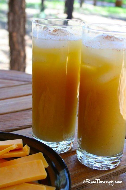 The Painkiller  (4 oz. pineapple juice 1 oz. orange juice 1 oz. coconut cream 3 oz. rum  Sprinkle of freshly grated nutmeg)