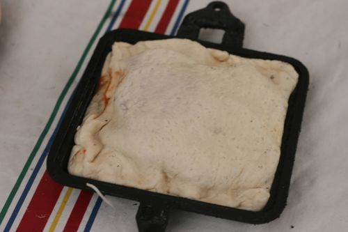 Pie Iron Calzone Recipe ~ premade pizza dough, cheese, pizza sauce, meat & anything else you like