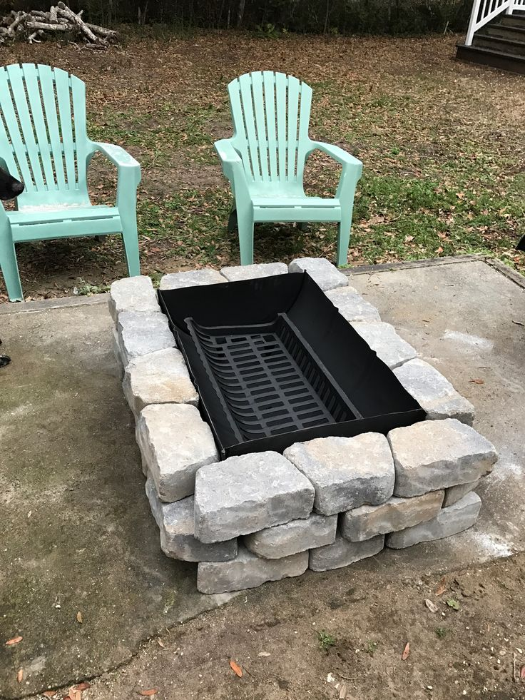 Inexpensive Fire Pit made from a 55 Gallon Drum, a grate from Northern Tool and blocks from Lowe's.