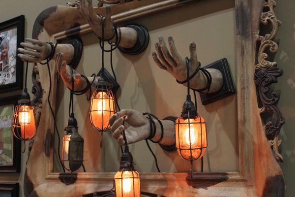 Creepy Hand Lantern - Gotta try this for Halloween; they sell kits you can use to cast plaster copies of your hands; shouldn't be too difficult... but time consuming, and no idea of the cost.