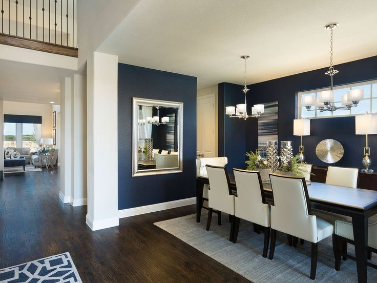 im loving the wall color and floor color meritage homes model home lantana beautiful navy walls dining room with ivory dining chairs modern chrome