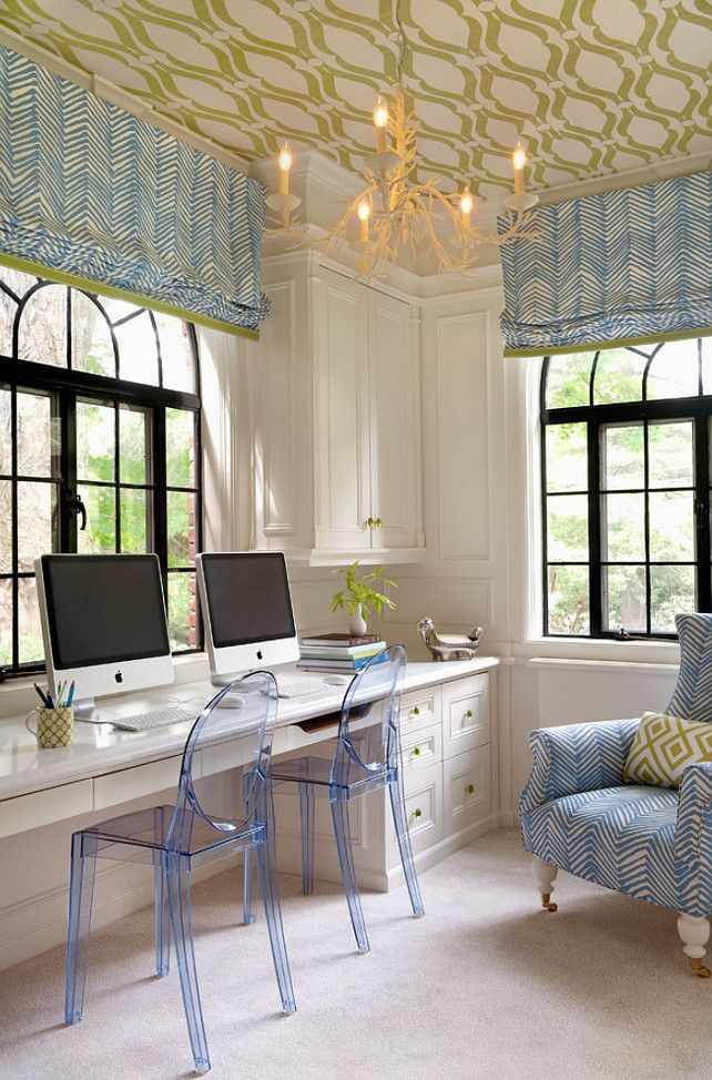 Home office design with wallpapered ceiling and chic chandelier