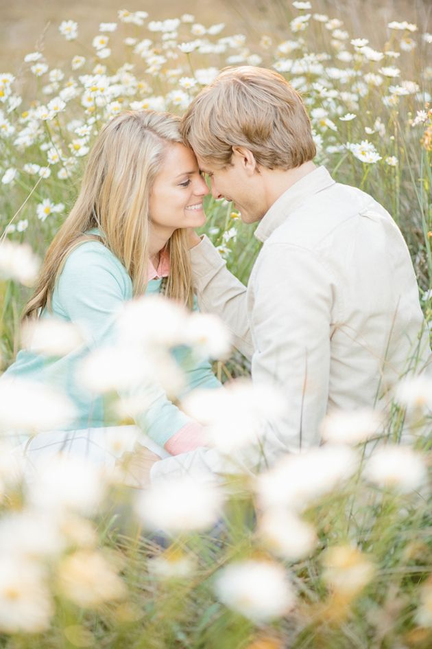 engagement shoot in a field of daisies