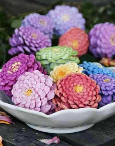Katie Loves …a new use for pinecones! While we love a pinecone craft for the holidays, this colorful project is great for spring and summer decor. Just paint the bottoms in bright colors with a yellow center, then group together like a bouquet of zinnias. Photo: A Fanciful Twist