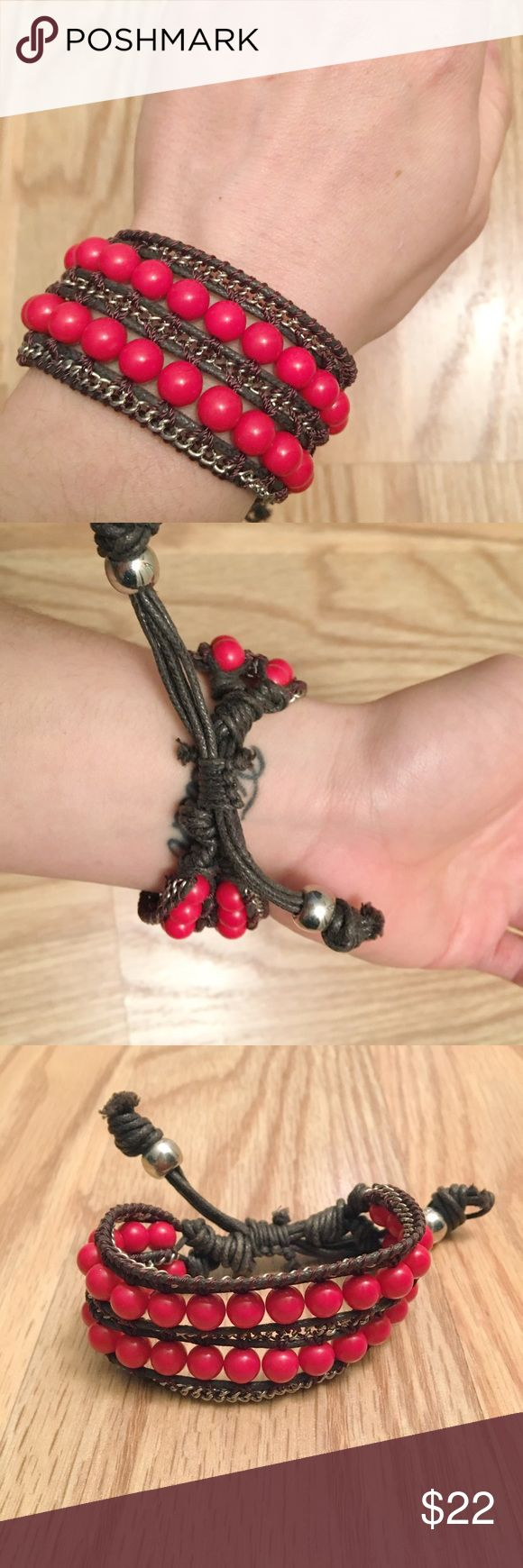 """NWOT Red and brown slip knot bracelet NWOT Brown cord bracelet with silver chain woven in   2 layers of coral red beads   has slip knot to adjust up to 10"""" long Jewelry Bracelets"""