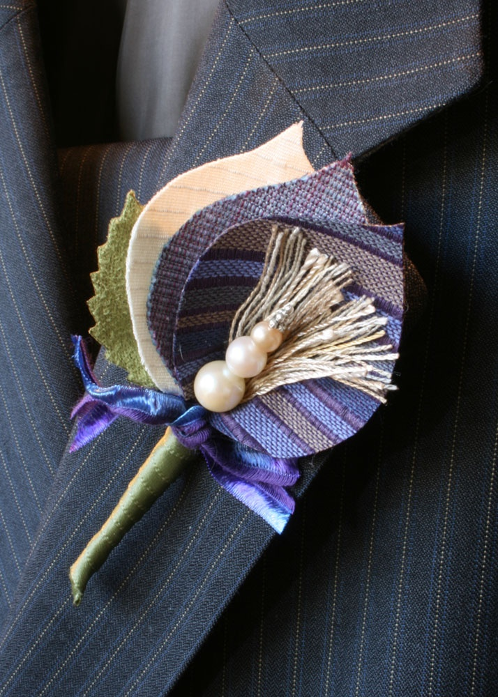 I like homemade boutonnieres from ribbon, fabric, or buttons.
