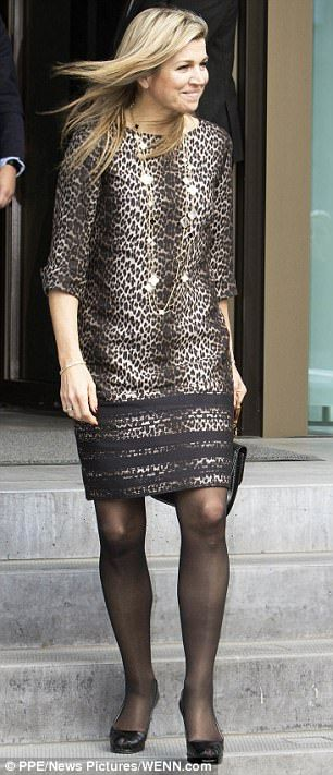 Fierce: Queen Maxima, 45, wore a leopard-print dress to the event at the Dutch Central Bank