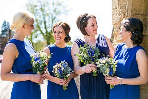 blue bridesmaids dresses // wildflower bouquets // @anna Marinovich