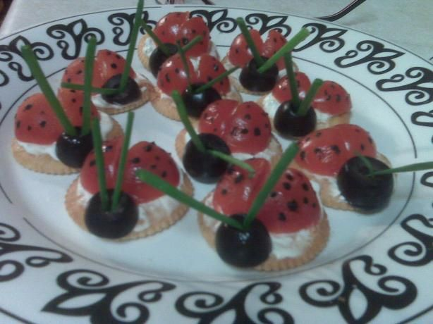 Ladybug Appetizers from Food.com: Cherry tomato quarters form the wings of these adorable little ladybugs. The delightful creatures are perched on crunchy crackers spread with a seasoned cream cheese mixture.