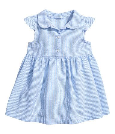 Blue/white striped. Striped dress in soft cotton seersucker with a rounded collar. Button placket, butterfly sleeves, seam at waist, and gathered skirt.