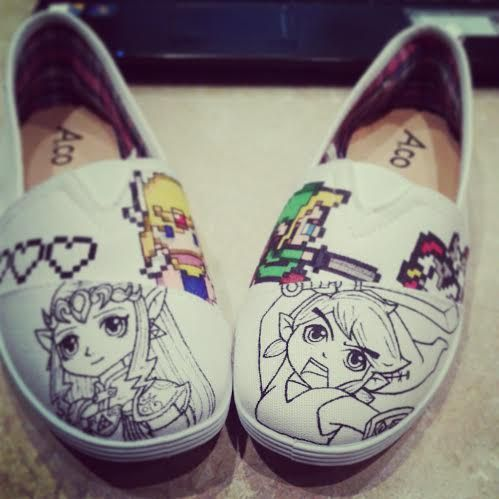 Working on some crazy Zelda shoes! See more details on my facebook page www.facebook.com/fauvebcreations :) #link #zelda #triforce #cuccos #shoe #art #sharpie #drawing #shoes