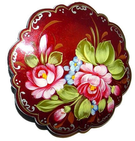 Old Russian folk handicraft of painting on metal trays, which still exists in a village of Zhostovo .