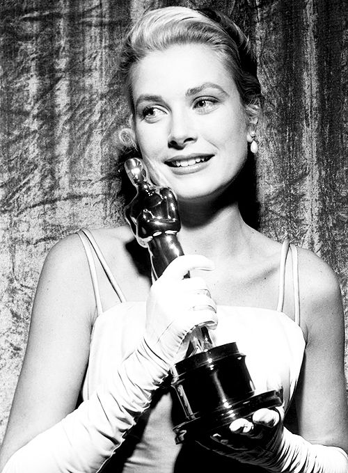 Grace Kelly holds her Oscar for Best Actress at the 27th Annual Academy Awards, 1954.