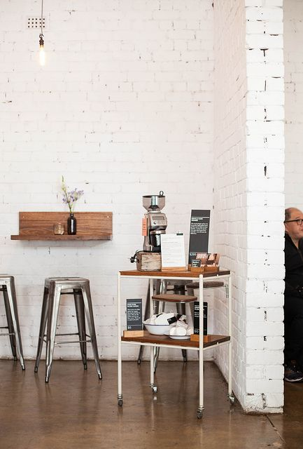 Love the floating shelf which can be used as a coffee table? Market Lane Coffee, Australia
