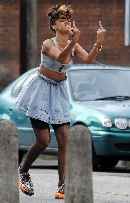 Rihanna - We Found Love. Giving the middle finger for the storyline of her video shoot.  Love the 1980's rebellious punk edge!