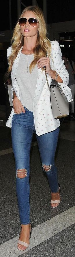 Rosie Huntington-Whiteley wears a Chloé jacket from the Spring-Summer 2014 collection and carries a Clare bag while arriving in Los Angeles, August 2014. #SS14 #chloeGIRLS