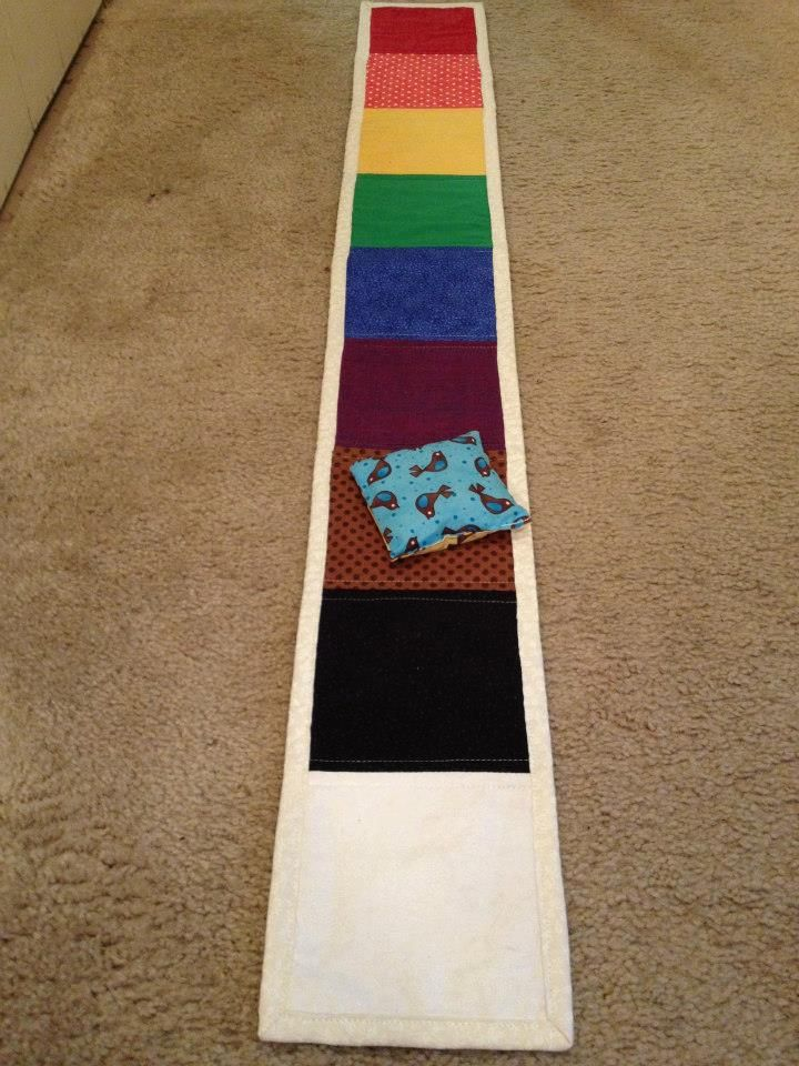 The Chorister's Corner: COLOR TOSS (Great and simple review game - would be fun to change things up a bit in Nursery, too.  She includes a list of songs to go with the rainbow colors.  Maybe St. Patrick's day??)