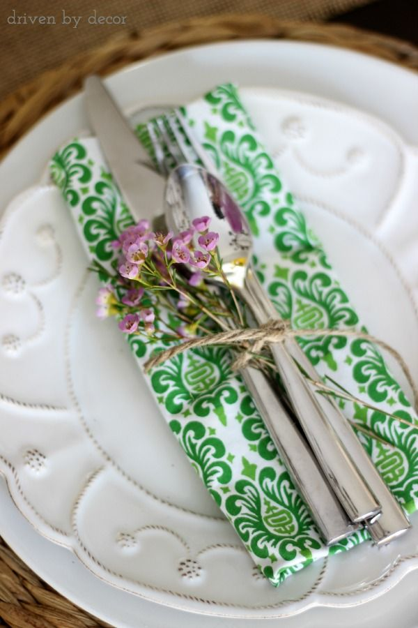 For a simple spring placesetting, tie together your guests' napkin & flatware with one or two floral sprigs.