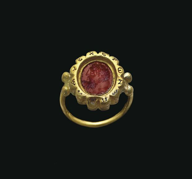 A ROMAN GOLD AND CARNELIAN FINGER RING  CIRCA 3RD-4TH CENTURY A.D. AND CIRCA 1ST CENTURY A.D.  [stone earlier than setting]