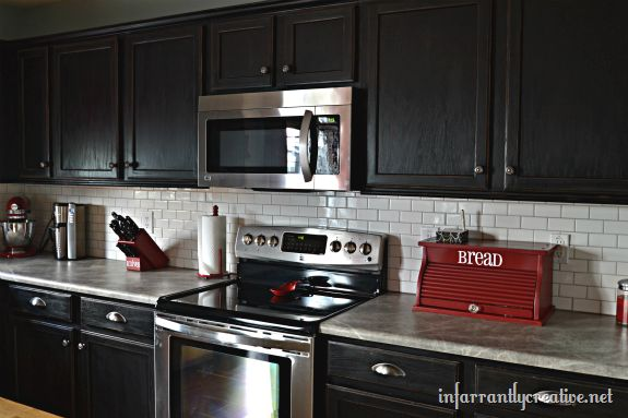 back splashes with dark cabinets | think the new faux slate countertops paired with the subway tile ...