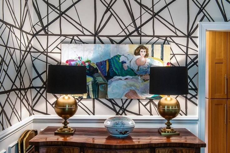 In the dining room, a pair of Arteriors Bishop table lamps with pink agate Hillary Thomas finials light up the Kelly Wearstler Channels wallpaper in ebony/ivory. Lee Jofa Foyer