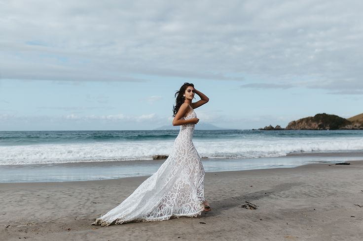 Bay by Lovers Society available at The Bridal Atelier www.thebridalatelier.com.au @thebridalatelier #sheisthebridalatelierbride || Fitted lace bohemian low back wedding dress with plunging v neckline front  || With Love, TBA xo.