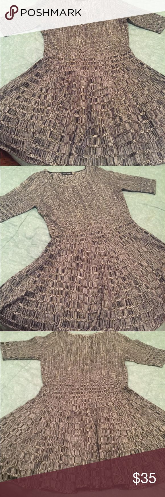 Ivanka Trump dress New never worn lost tags. Checkered Grey and black dress skater style dress hits below the knee with short sleeves sweater like material perfect for a date, going out with the girls, and or work. Ivanka Trump Dresses High Low