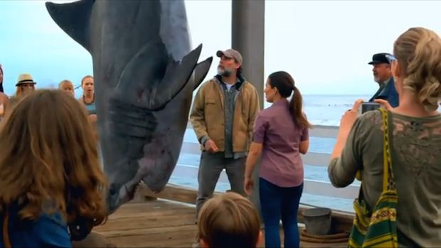"""Fans of """"Shark Week"""" might recall the shocking but clever promo for the popular Discovery Channel series June 2013, when Snuffy the rehabilitated harbor seal was devoured by a leaping great white shark just before its much-hyped release back into the ocean.  Well, it turns out that Snuffy the Seal, thanks to the marvels of fiction, has survived the ordeal on Sunrise Pier.  Check out the new promo for Shark Week 2014"""