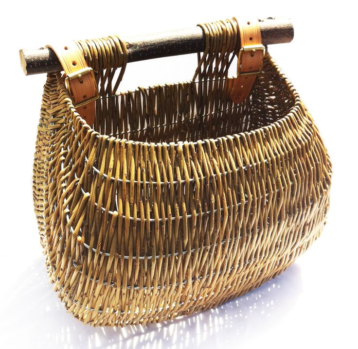 Claire Gaudion makes willow fishing baskets in the traditional Guernsey way, and as well as still being used by a few Guernsey fishermen, they have many contemporary uses today - shopping baskets, bicycle panniers, carriers for gardening tools, magazine racks, kindling storage and kitchen baskets for bread, and vegetables. Each basket is hand woven individually and is therefore unique.