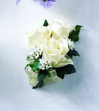 Mother-of-the-Bride Pin-On Corsage. 3 white roses with greens and baby's breath. Ribbon bow but different color.