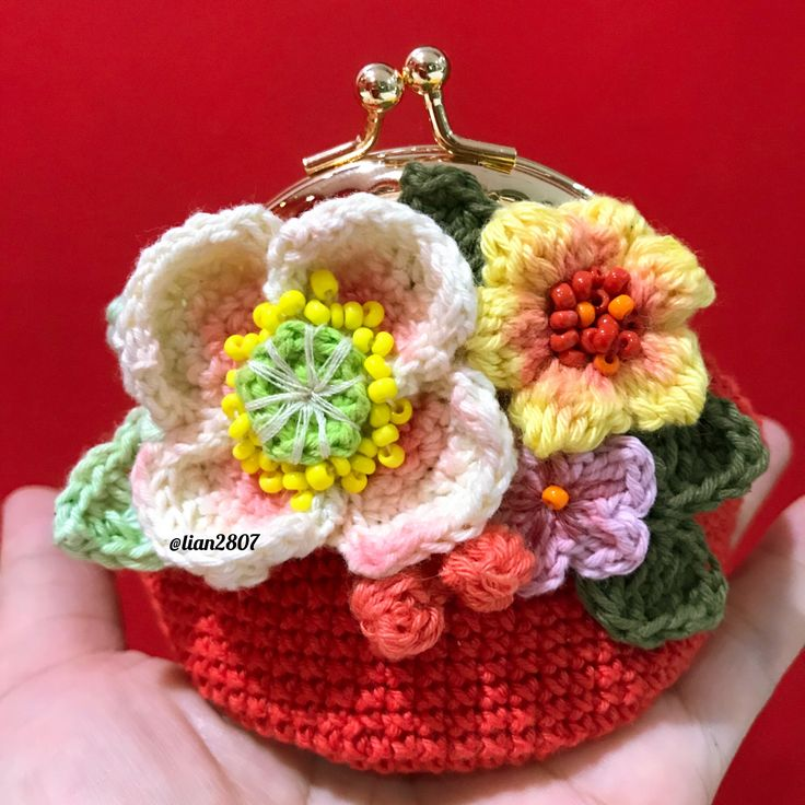 Crocheted colorful flowery pouch