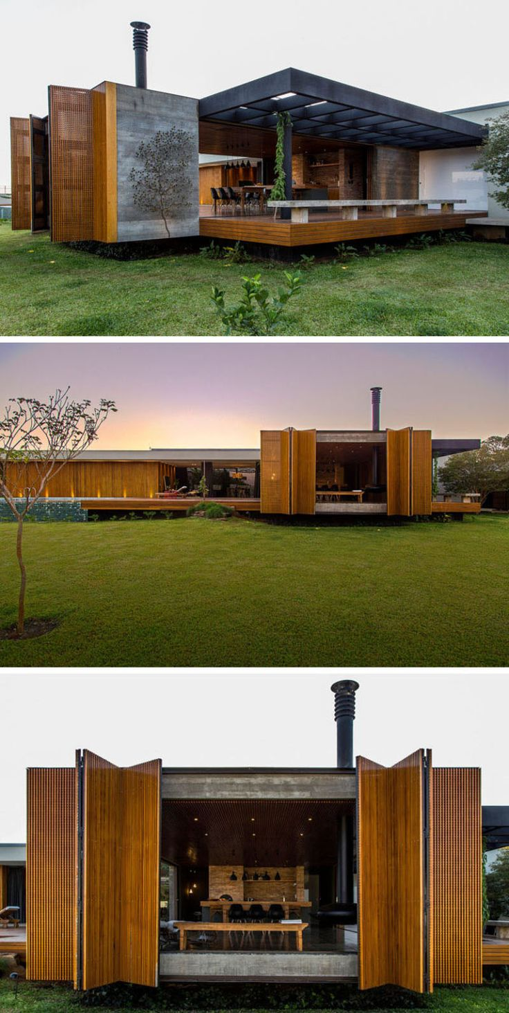 15 Examples Of Single Story Modern Houses From Around The World | This single story house is made from warm materials and features things like uplighting, mechanical shutters, and a simple design that give it a contemporary look.