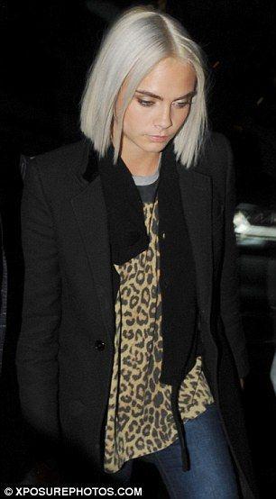 Cara Delevingne shows off platinum blonde locks in Paris | Daily Mail Online