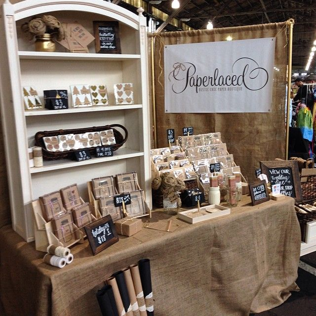 I love how the entire booth is pulled together with the burlap. This is a good example of using height to display product.