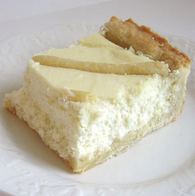 This recipe for traditional Polish cheesecake or sernik has a sweet pastry crust and a dry curd cheese filling. It is baked in a 13x9-inch pan for easy serving.
