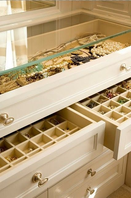 massive jewelry dresser in the perfect closet. yes, please.  Glass topped case with velvet lined jewelry drawer for necklaces and dividers in drawers for rings broaches and earrings