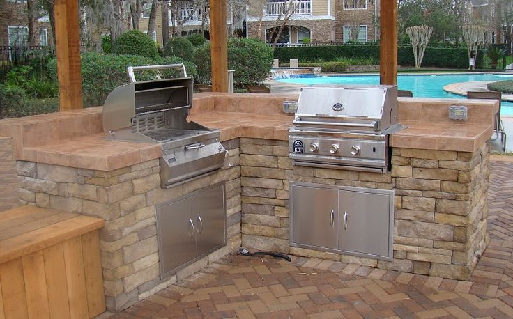 #outdoor kitchen and #grilling area with beautiful #stone and #bricks