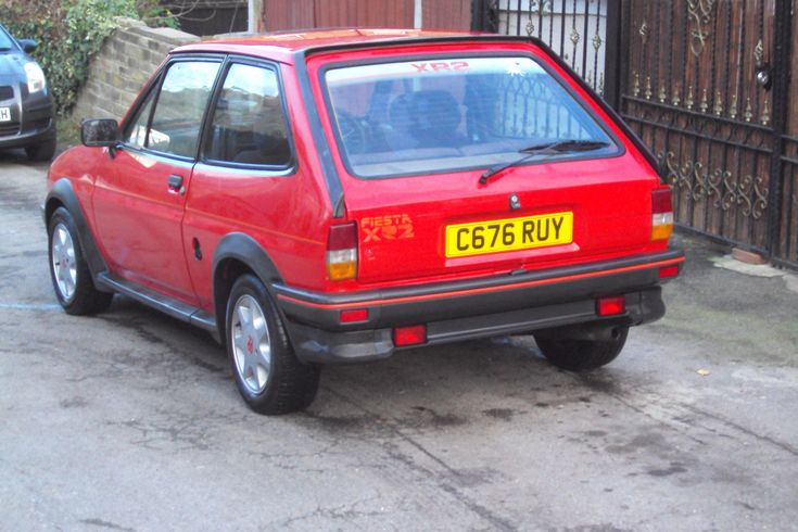 Click the link to see more pics and details of this !1985 (c) genuine fiesta xr2 red soild project car!